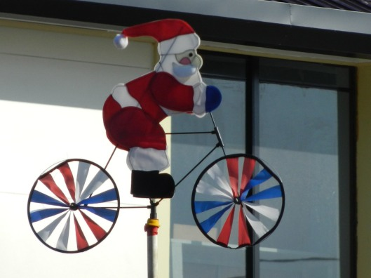 Santa Clause On A Bicycle